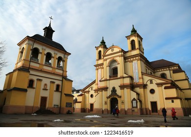 UKRAINE, IVANO-FRANKIVSK, FEBRUARY 23, 2017: People near church of the Blessed Virgin Mary, an now art museum on Sheptitskogo Square in Ivano-Frankivsk city, western Ukraine