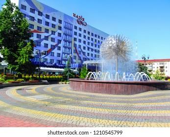 Ukraine, Ivano-Frankivsk - June 05, 2015: Fountain on the Nezalezhnosti Street near 'Nadiya' Hotel in Ivano-Frankivsk. Beautiful ball-shaped 'Dandelion' fountain in the square on a sunny summer day