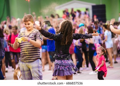 UKRAINE - JULY 30, 2017: Young people at the festival of colors Holi on July 30, 2017 in Kremenchug, Ukraine