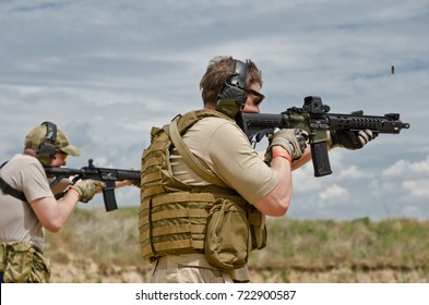 """UKRAINE - JUNE 17 2017: The civil men are trained to fire at the outdoor shooting range during """"Open Gun Day"""". UKRAINE - JUNE 17 2017."""