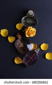 Ukraine - June 3, 2017: Perfumes set on black background with rose flower