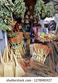 UKRAINE, KHARKIV - JULY 25, 2018 : City market of Ukrainian homewares. Store selling brooms made of straw, tree branches and plastic for sauna or bathhouse, for sweeping floors in house and outdoor