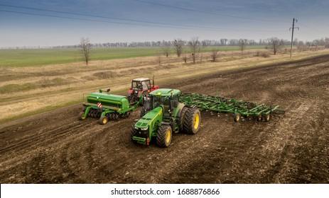 Ukraine, Kharkiv Oblast, March 30, 2020, Field cultivation before sowing, John Deere 8370r