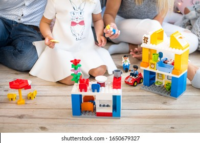 Ukraine, Kharkov, 06/18/2017. The family plays fun in the constructor of the company Lego