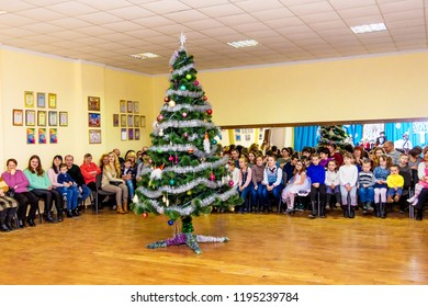 Ukraine. Khmelnytskyi. December 2017. Children on the New Year's Eve party in the hall near the Christmas tree