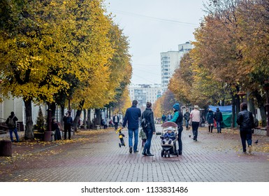 Ukraine. Khmelnytskyi. October 2016. The central street of the city with trees on the roadside in the autumn in the rainy weather