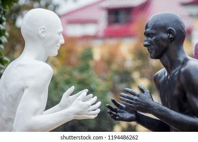 Ukraine. Khmelnytskyi. October 2018. Sculptures by Viktor Sidorenko. The dialogue of representatives of two races. Understanding between people with different skin colors