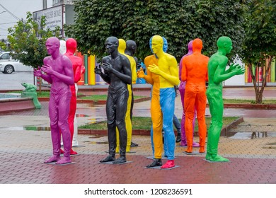 Ukraine. Khmelnytskyi. October 2018. Sculptures by V. Sidorenko. Multicolored sculptures of people. The dialogue of representatives of different races. Understanding between people with different skin
