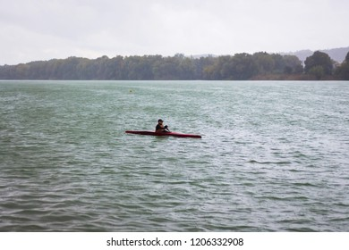 Ukraine. Khmelnytskyi. October 2018.   Young boy on a sports boat during training in rainy weather