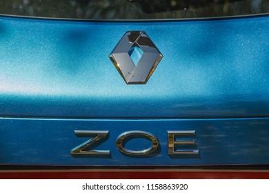 Ukraine, Kiev 11-08-18: test drive of an electric car Renault Zoe. Renault Zoe electric hybrid car logo close-up