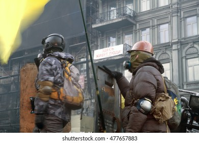 Ukraine, Kiev, 26 January 2014: a clash of radical Protestants Maidan right sector with riot police forces of Yanukovych in the street Grushevskogo - the conflict moved to the street fighting
