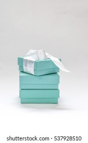 Ukraine, Kiev - December 17, 2016:Genuine Tiffany box, put on each other, the upper box tied with silk ribbon and offset, on a white background