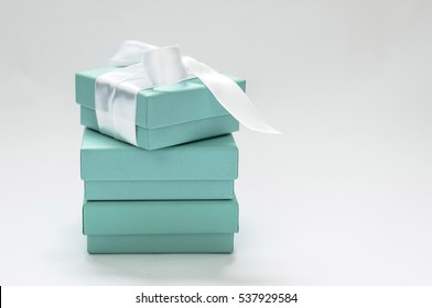 Ukraine, Kiev - December 17, 2016:Genuine Tiffany box, put on each other, the upper box tied with silk ribbon and offset, on a white background closeup