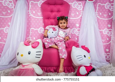 Ukraine Kiev December 24, 2016: two girls in the pajamas of hello kitty at a photo shoot in the studio. Pajama cheerful photo shoot hello kitty