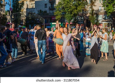 UKRAINE. KIEV - JULY 18, 2015: Krishnaites dancing on Khreshchatyk street, Kreshatik street