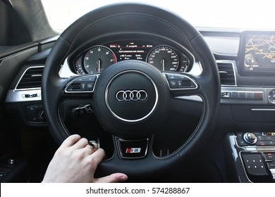 Ukraine, Kiev. March 20, 2015. A man holds the steering wheel of a luxury car. Gold ring on his hand. Audi S8. Editorial photo.
