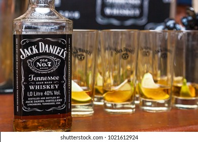 Ukraine Kiev May 14, 2016: Bottles and glasses for cocktail Jack Daniel Tennis whiskey. Jack Daniel is the brand of the sour whiskey of Tennessee, which is the best-selling American whiskey in the