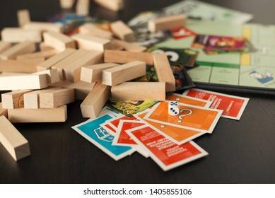 Ukraine, Kiev. May 23, 2019. colorful play figures and cards with dice on board.  Monopoly, jenga, saboter