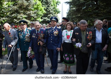 UKRAINE, KIEV, MAY 9, 2016, Victory Day, May 9. Monument to an unknown soldier: Veterans of World War II carry flowers to the monument of an unknown soldier