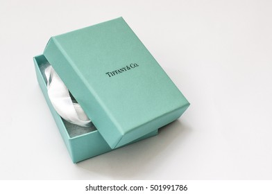Ukraine, Kiev - October 19, 2016: Open Tiffany branded box with a silk ribbon inside  on a white background