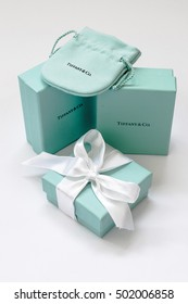 Ukraine, Kiev - October 19, 2016: Two brand Tiffany boxes, standing side by side, one Tiffany box with a white silk ribbon and corporate fabric cover on a white background