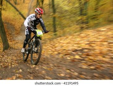 "UKRAINE, KIEV - OCTOBER 24: Pogrebenko Andriy professional biker with blurred background, at the professional bicycle competition ""Dubki"" closing, on October 24, 2009 at Ukraine, Kiev."