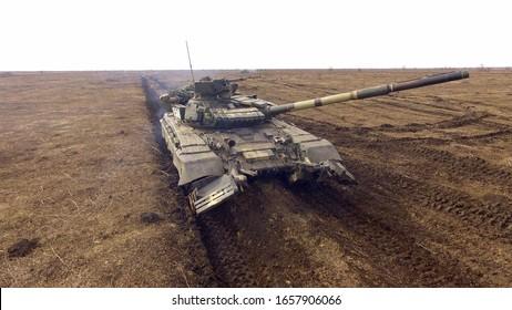 Ukraine, Kiev region, February 25, 2020,Tank company drills,T-64 tank on the battlefield, photo from a drone.