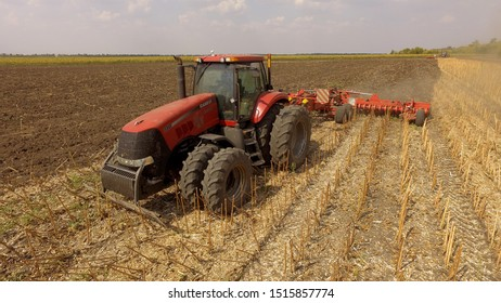 Ukraine, Kiev region, September 15, 2019, heavy machinery works in the fields of the region, a tractor plows the land, photo from a drone.Tractor in the field cultivates the land