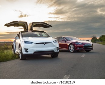 Ukraine, Kiev, September 14, 2017: Electric car Tesla on a country road, photo of Tesla in the evening at sunset
