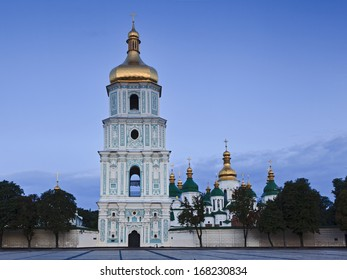 Ukraine Kiev Sofia ancient monastery complex of buildings of entrance gate bell tower and other cathedral domes at sunrise