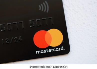 Ukraine, Kremenchug - February, 2019: Close up of Mastercard credit card isolated on the white background. Mastercard is one of the biggest credit card companies in the world