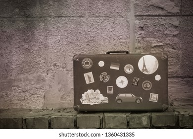 UKRAINE, KYIV, 1 JANUARY 2019: old fashioned photo of briefcase covered with different travel stickers