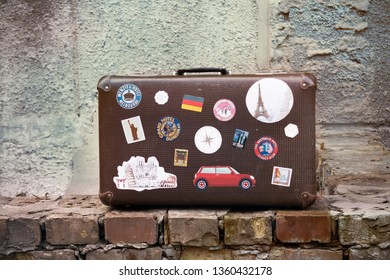 UKRAINE, KYIV, 1 JANUARY 2019: vintage photo of suitcase on brick wall