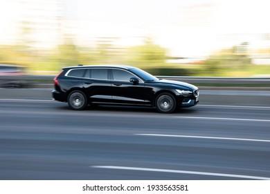 Ukraine, Kyiv - 10 December 2020: Black Vovo V60 car moving on the street