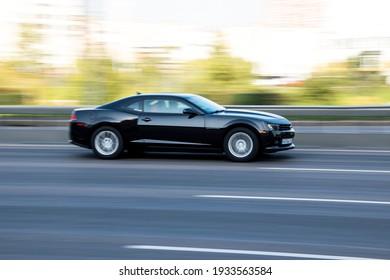 Ukraine, Kyiv - 10 December 2020: Black Chevrolet Camaro car moving on the street