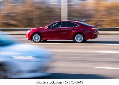 Ukraine, Kyiv - 11 March 2021: Red Lexus ES car moving on the street;