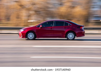 Ukraine, Kyiv - 11 March 2021: Red Toyota Corolla car moving on the street;