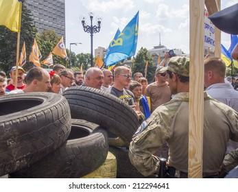 UKRAINE, KYIV - 12 Aug, 2014: Car tires on a symbolic barricade near the Verkhovna Rada. Hundreds of people gather by the Ukrainian Parliament to demand the lustration