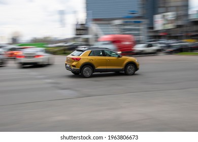 Ukraine, Kyiv - 20 April 2021: Yellow Volkswagen T-Roc car moving on the street. Editorial