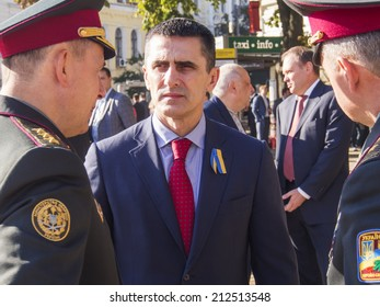 UKRAINE, KYIV - 23 Aug, 2014: Defense Minister Valery Geletey surrounded by generals. -- Sophia Square on the official flag-raising ceremony in honor of the Ukrainian flag.