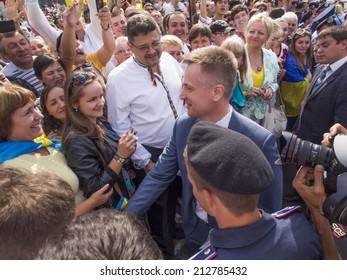 UKRAINE, KYIV - 23 Aug, 2014: Chairman of the Security Service of Ukraine Valentyn Nalyvaychenko shakes hands parade spectators. In Kiev, the first time in five years, was the official military parade
