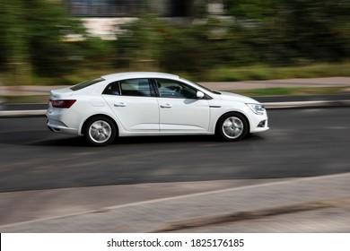 Ukraine, Kyiv - 28 September 2020: White Renault Megane IV Sedan car moving on the street