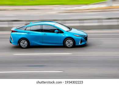 Ukraine, Kyiv - 29 September 2020: Blue Toyota Prius car moving on the street
