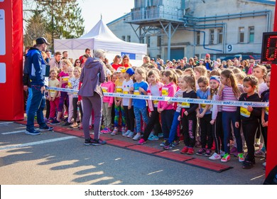 Ukraine, Kyiv - April 6, 2019:  Runners start line. Sprinters ready to run. Children's competition in running and athletics - training before the marathon.