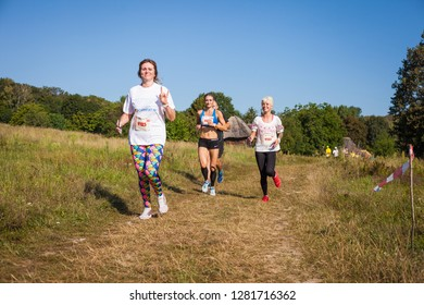 """Ukraine, Kyiv - August 24, 2018: Running people. Competitions in honor of the Independence Day """"Race in embroidered shirts""""."""