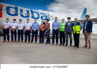 Ukraine, Kyiv - July 8, 2020: Personnel - captains, pilots and flight attendants in medical masks. Passenger aircraft Boeing 737-800 Flydubai Airlines plane A6-FEP. People at the Airport.