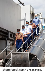 Ukraine, Kyiv - July 8, 2020: The pilot, captain and flight attendant are personnel, a team in medical masks. Masked people at work. Flydubai Airlines A6-FEP. Boryspil International Airport.