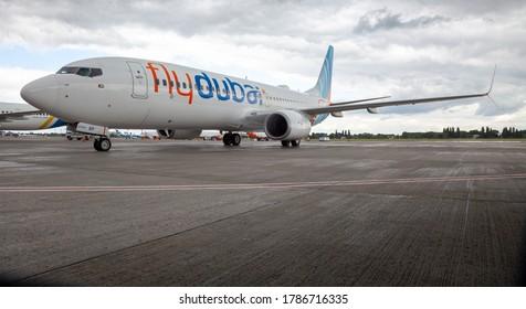 Ukraine, Kyiv - July 8, 2020: Passenger aircraft Boeing 737-800 next-generation Flydubai Airlines A6-FEP. Boryspil International Airport. Plane arrival of the aircraft on the platform. Apron runway.