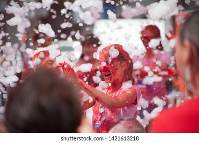 "Ukraine, Kyiv - June 2, 2019: A foam party. Children and adults are having fun. ""Kyiv Color Run"" - fun run with spraying Holi colors."