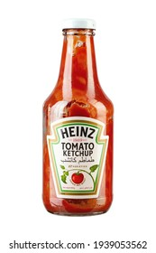 Ukraine, Kyiv - March 19, 2021: Bottle of Heinz Ketchup isolated on white background. Used ketchup bottle. File contains clipping path.